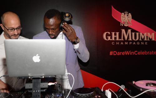 Usain_Bolt_and_Didier_Mariotti-Mumm_DJ_battle.jpg
